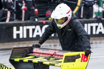 Sebastien Bourdais, Dale Coyne Racing with Vasser-Sullivan Honda, crewman prepares to push car off of the grid for a wet race start