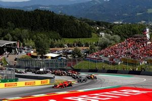 Charles Leclerc, Ferrari SF90, leads Valtteri Bottas, Mercedes AMG W10, Lando Norris, McLaren MCL34, Lewis Hamilton, Mercedes AMG F1 W10, Kimi Raikkonen, Alfa Romeo Racing C38, and the rest of the field at the start