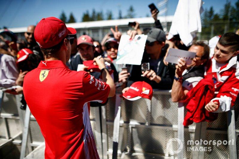 Sebastian Vettel, Ferrari signs a autograph for a fan
