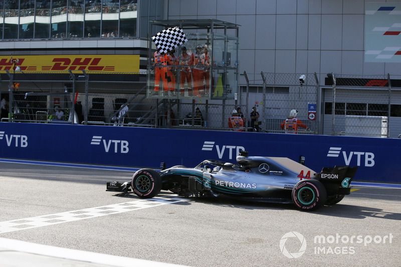 Lewis Hamilton, Mercedes AMG F1 W09 crosses the line with the checkered flag