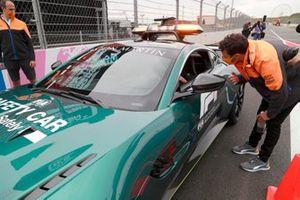 Daniel Ricciardo, McLaren talks with Aston Martin Vantage Safety Car drivers