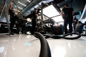 The Mercedes team in the garage with Lewis Hamilton, Mercedes W12