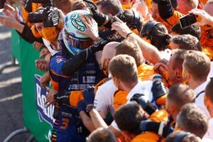 Daniel Ricciardo, McLaren, 1st position, celebrates with his team in Parc Ferme