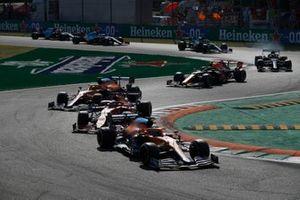 Daniel Ricciardo, McLaren MCL35M, Charles Leclerc, Ferrari SF21, and Lando Norris, McLaren MCL35M