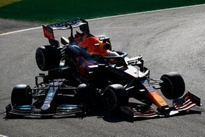 Lewis Hamilton, Mercedes W12, and Max Verstappen, Red Bull Racing RB16B, crash out of the race