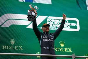 Valtteri Bottas, Mercedes, 1st position, lifts his trophy
