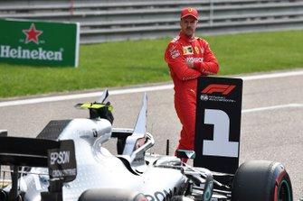 Sebastian Vettel, Ferrari, inspects the Mercedes AMG F1 W10 of his rivals