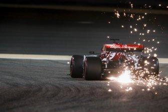 Sparks fly from the rear of Kimi Raikkonen, Alfa Romeo Racing C38