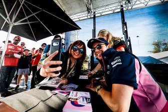Sergio Perez, Racing Point poses for a selfie with a fan