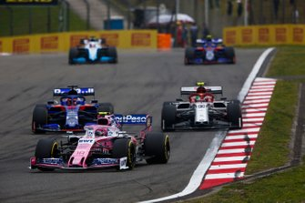 Lance Stroll, Racing Point RP19, leads Daniil Kvyat, Toro Rosso STR14, and Antonio Giovinazzi, Alfa Romeo Racing C38