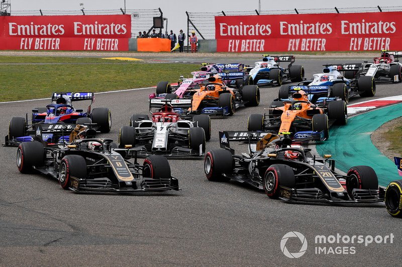 Kevin Magnussen, Haas F1 Team VF-19, leads Romain Grosjean, Haas F1 Team VF-19, Kimi Raikkonen, Alfa Romeo Racing C38, Daniil Kvyat, Toro Rosso STR14, Lando Norris, McLaren MCL34, Carlos Sainz Jr., McLaren MCL34, and the remainder of the field at the start