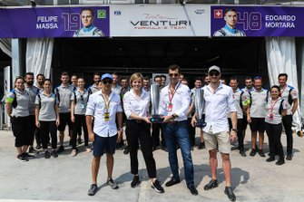 Edoardo Mortara, Venturi Formula E, Susie Wolff, Team Principal, Venturi Formula E, receive the winners' trophies from the previous race in Hong Kong, in which Mortara was declared the winner post-race. Felipe Massa, Venturi Formula E, is also present with the remainder of the Venturi team
