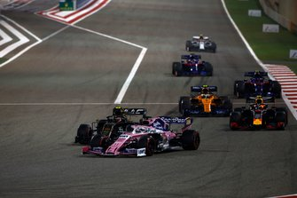 Sergio Perez, Racing Point RP19, leads Kevin Magnussen, Haas F1 Team VF-19, Pierre Gasly, Red Bull Racing RB15, and Lando Norris, McLaren MCL34