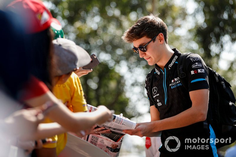George Russell, Williams Racing signs autographs for fans