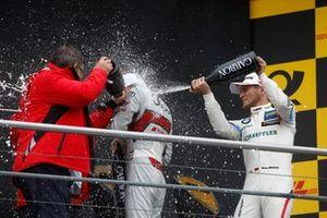 Подиум: чемпион Рене Раст, Audi Sport Team Rosberg, третье место – Марко Виттман, BMW Team RMG, и член правления Audi AG Ханс-Йоахим Ротенпилер