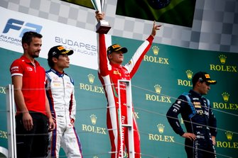 Nobuharu Matsushita, Carlin, Race winner Mick Schumacher, Prema Racing and Sergio Sette Camara, Dams celebrate on the podium