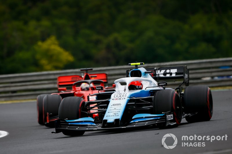 Robert Kubica, Williams FW42, leads Sebastian Vettel, Ferrari SF90