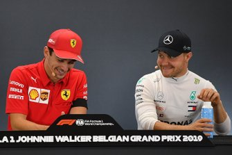 Charles Leclerc, Ferrari, 1st position, and Valtteri Bottas, Mercedes AMG F1, 3rd position, in the Press Conference