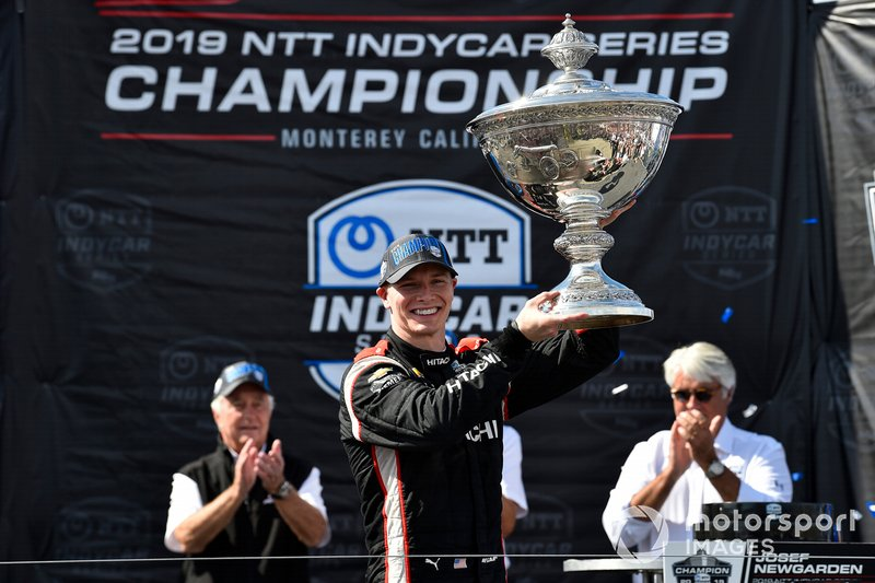 Josef Newgarden, Team Penske Chevrolet celebrates NTT IndyCar championship on podium with Astor Cup