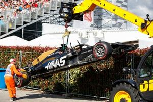 The Romain Grosjean Haas F1 Team VF-19 is removed by a crane