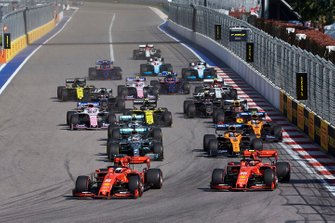 Sebastian Vettel, Ferrari SF90, leads Charles Leclerc, Ferrari SF90, Lewis Hamilton, Mercedes AMG F1 W10, Carlos Sainz Jr., McLaren MCL34, Valtteri Bottas, Mercedes AMG W10, Lando Norris, McLaren MCL34, and the rest of the field at the start