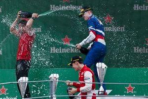Marcus Armstrong, PREMA Racing, Race winner Robert Shwartzman, PREMA Racing on the podium with the champagne