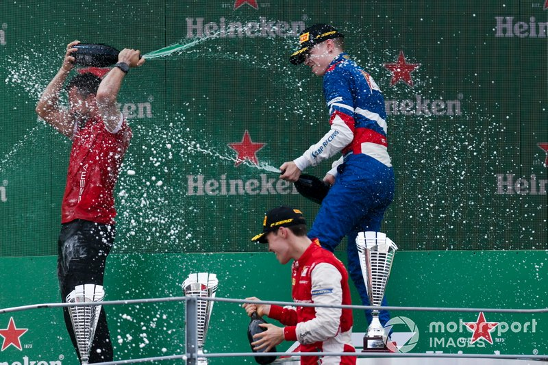 Marcus Armstrong, PREMA Racing, Race winner Robert Shwartzman, PREMA Racing on the podium with the champagne