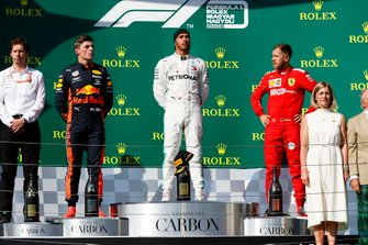 Max Verstappen, Red Bull Racing, 2nd position, Lewis Hamilton, Mercedes AMG F1, 1st position, and Sebastian Vettel, Ferrari, 3rd position, on the podium