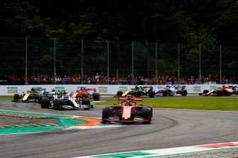 Charles Leclerc, Ferrari SF90, leads Lewis Hamilton, Mercedes AMG F1 W10, Valtteri Bottas, Mercedes AMG W10, Sebastian Vettel, Ferrari SF90, and the rest of the field at the start