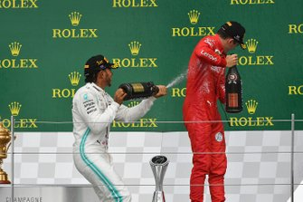 Lewis Hamilton, Mercedes AMG F1, 1st position, sprays Charles Leclerc, Ferrari, 3rd position, with Champagne