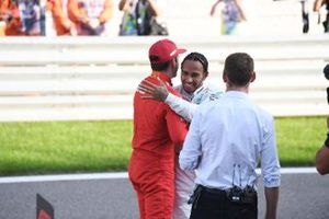 Lewis Hamilton, Mercedes AMG F1, congratulates Charles Leclerc, Ferrari, on securing pole