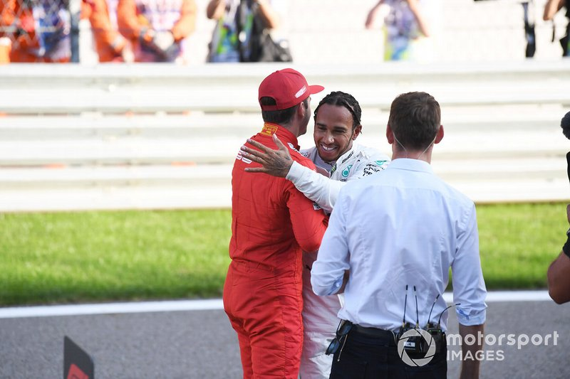 Lewis Hamilton, Mercedes AMG F1, congratulates Charles Leclerc, Ferrari, on securing pole