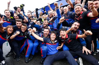 The Toro Rosso team celebrate a podium finish