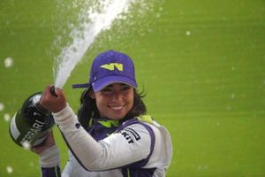 Jamie Chadwick, 1st position, celebrates on the podium with Champagne