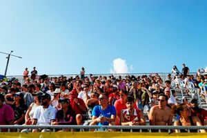 Fans watch from a grandstand
