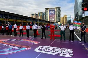 Drivers and team members observe a minutes silence for the late Mansoir Ojjeh on the grid