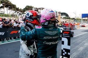 Pierre Gasly, AlphaTauri, 3rd position, and Sebastian Vettel, Aston Martin, 2nd position, celebrate in Parc Ferme