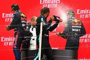 Gianpiero Lambiase, Race Engineer, Red Bull Racing, Sergio Perez, Red Bull Racing, 3rd position, Lewis Hamilton, Mercedes, 2nd position, and Max Verstappen, Red Bull Racing, 1st position, spray Champagne on the podium
