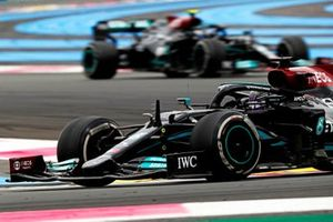 Sir Lewis Hamilton, Mercedes W12, leads Valtteri Bottas, Mercedes W12