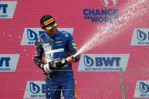 Lando Norris, McLaren, 3rd position, celebrates on the podium with Champagne