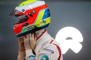 Oliver Turvey, NIO Formula E Team, puts on his helmet in the garage