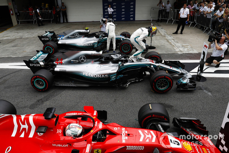 Lewis Hamilton, Mercedes AMG F1, celebrates pole position in parc ferme between Valtteri Bottas, Mercedes AMG F1 W09, and Sebastian Vettel, Ferrari SF71H.