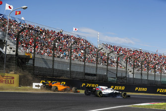 Fernando Alonso, McLaren MCL33, runs off the track behind Lance Stroll, Williams FW41