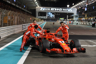 Ferrari mechanics with Ferrari SF71H