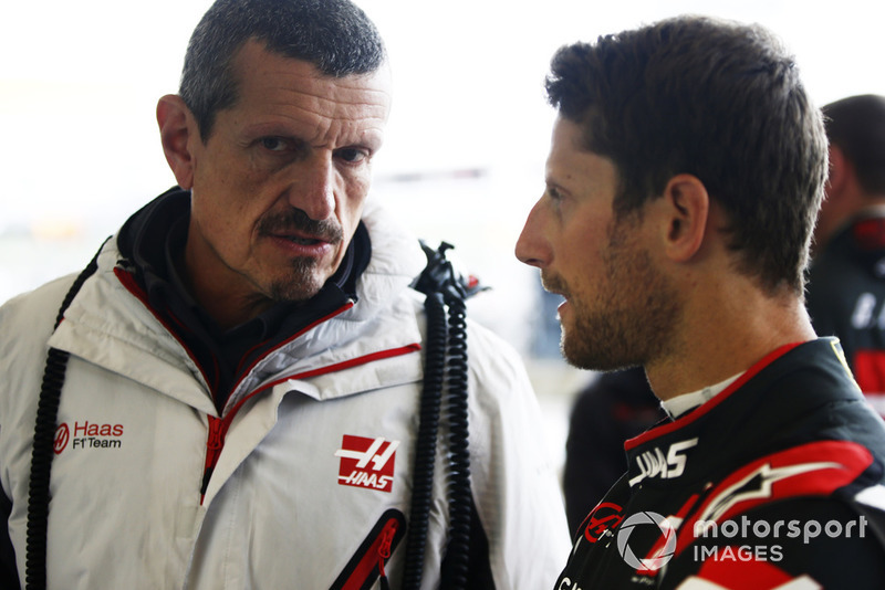 Romain Grosjean, Haas F1 Team, talks with Guenther Steiner, Team Principal, Haas F1, in the garage.