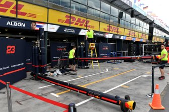 Red Bull personnel pack away equipment in the pitlane