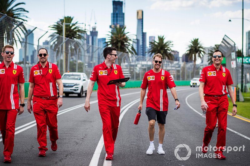 Sebastian Vettel, Ferrari walks the track with members of the team