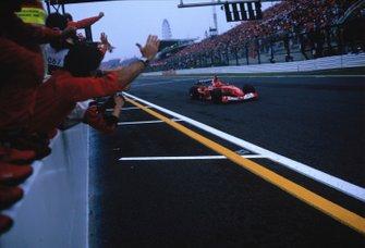 Race winner Rubens Barrichello, Ferrari F2003 GA, crosses finish line