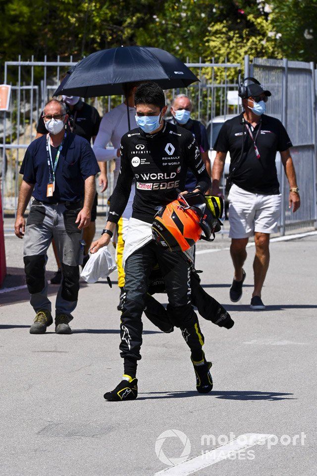 Esteban Ocon, Renault F1, walks back to his garage after a crash