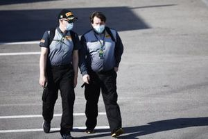 Pirelli personnel, including Anthony Peacock, arrive at the circuit